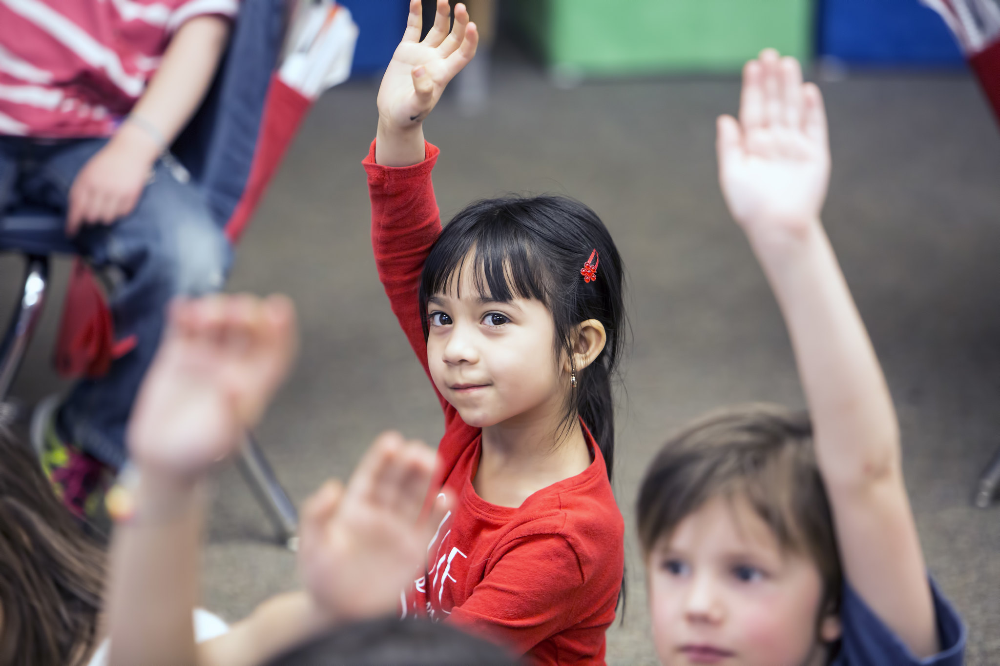 girl with raised hand
